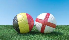 Dos balones de fútbol en colores de las banderas libre illustration