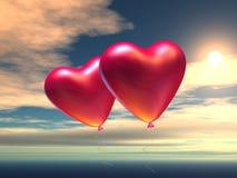 Dos baloons en forma de corazón Imágenes de archivo libres de regalías