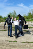 Dos bandidos secuestraron a un hombre de negocios Fotografía de archivo libre de regalías