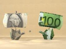 Dos barcos de papel que representan el dólar y el eu Foto de archivo