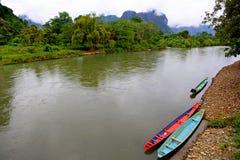 Dos barcos en un río en Laos Fotos de archivo libres de regalías
