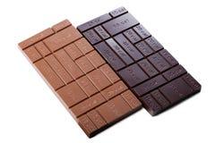 Dos barras de chocolate con la indicación de calorías Foto de archivo libre de regalías