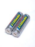 Dos baterías recargables del AA en un fondo blanco Imagenes de archivo