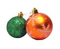 Dos bolas de la Navidad de naranja y de verde Imagen de archivo