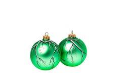 Dos bolas verdes pintadas a mano de la Navidad Fotografía de archivo