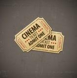 Dos boletos viejos del cine para el cine sobre fondo del grunge Imágenes de archivo libres de regalías