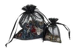 Dos bolsas netas con joyería foto de archivo