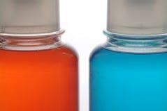 Dos botellas coloreadas Foto de archivo libre de regalías