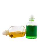 Dos botellas con aceites aromáticos Foto de archivo