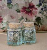 Dos botellas con las hierbas secadas Imágenes de archivo libres de regalías