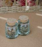 Dos botellas con las hierbas secadas Imagenes de archivo