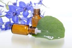 Dos botellas con los glóbulos de la homeopatía Foto de archivo libre de regalías