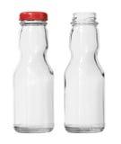 Dos botellas de cristal de la salsa de tomate vacía aisladas en el fondo blanco cli foto de archivo libre de regalías
