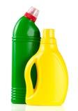 Dos botellas de despedregadoras aisladas en el fondo blanco Imagen de archivo