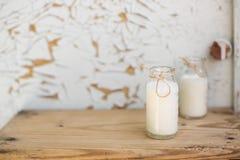 Dos botellas de leche Imagen de archivo libre de regalías
