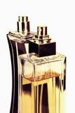 Dos botellas de perfume aisladas en blanco Imágenes de archivo libres de regalías