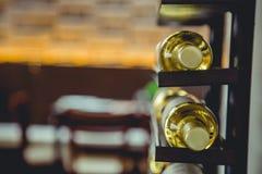 Dos botles del vino en un soporte imágenes de archivo libres de regalías