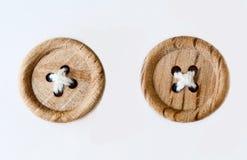 Dos botones cosidos de madera Fotos de archivo