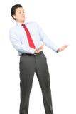 Dos braços homem de negócios do hispânico da postura de Defesnive para fora Foto de Stock Royalty Free
