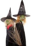 Dos brujas verdes de víspera de Todos los Santos Fotografía de archivo