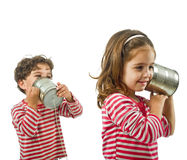 Dos cabritos que hablan en un teléfono del estaño Imagen de archivo