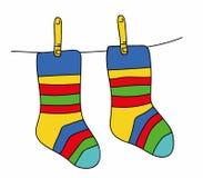 Dos calcetines rayados colgantes Imagen de archivo libre de regalías