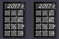 Dos calendarios con año abstracto del fondo del bokeh en 2017 Foto de archivo
