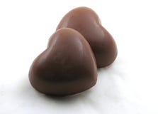 Dos caramelos del corazón del chocolate Foto de archivo