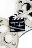 Dos carretes de la película para el proyector de película de 35 milímetros con el tablero de chapaleta y Fotografía de archivo libre de regalías