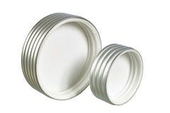 Dos casquillos roscados aluminio para los tarros fotografía de archivo
