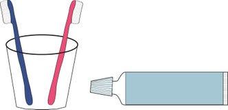 Dos cepillos de dientes y cremas dentales Fotos de archivo