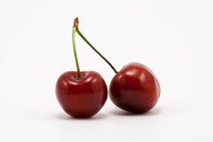 Dos cerezas rojas de rubíes jugosas Imagen de archivo