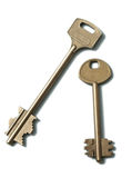 Dos claves del oro en un fondo blanco imagen de archivo libre de regalías