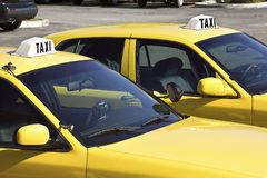 Dos coches del taxi Imágenes de archivo libres de regalías