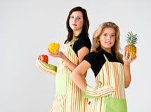 Dos cocineros adolescentes Imagenes de archivo