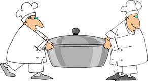 Dos cocineros que llevan un crisol grande Imagen de archivo