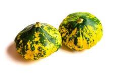 Dos coloridos hermosos con squ de la cacerola de la empanada de los puntos verdes y amarillos imagen de archivo