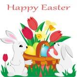 Dos conejos lindos de Pascua y una cesta de mimbre con los huevos pintados, tulipanes, narcisos en hierba verde libre illustration