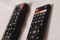 Dos controles remotos de la TV fotografía de archivo
