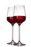 Dos copas de vino rojas en blanco Imagen de archivo libre de regalías