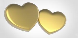 Dos corazones amarillos 3D del oro en el fondo gris gris blanco Fotos de archivo libres de regalías