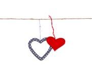 Dos corazones colgados para arriba en la cadena Fotografía de archivo