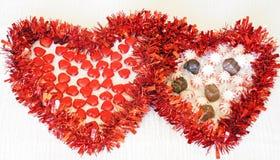 Dos corazones con el caramelo fotos de archivo libres de regalías