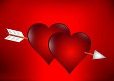 Dos corazones con la flecha Fotos de archivo