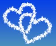 Dos corazones de las nubes Foto de archivo libre de regalías