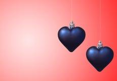 Dos corazones de Navidad en rojo Imagen de archivo