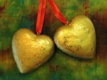 Dos corazones de oro Foto de archivo libre de regalías