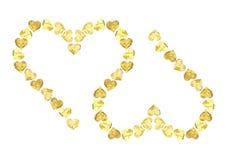 Dos corazones del oro Imágenes de archivo libres de regalías