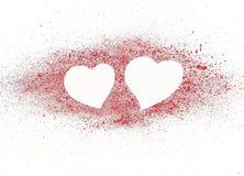 Dos corazones en el rojo. Fotografía de archivo