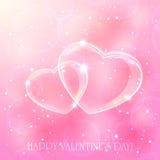 Dos corazones en fondo rosado Imágenes de archivo libres de regalías